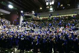 The New Caney High School Class of 2017 celebrates graduation with the traditional cap throw at the M.O. Campbell Educational Center May 27.
