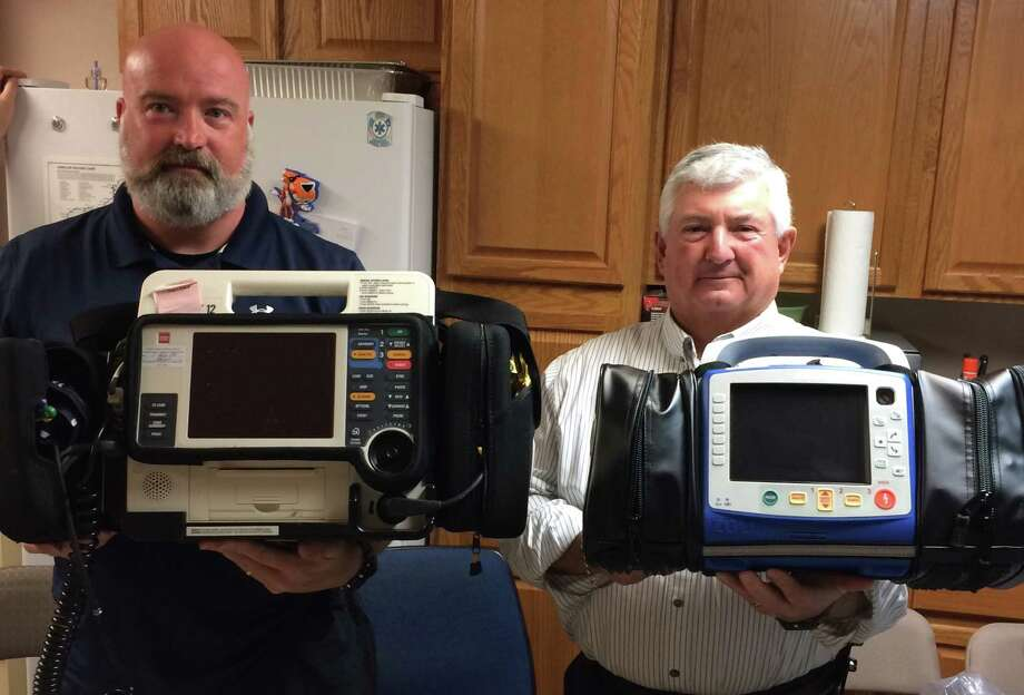 Liberty County EMS paramedic Dana Holst and director Mike Koen compare old heart monitors (left) with newer, smaller, lighter, and more powerful Zoll X Series monitors (right). Photo: Submitted
