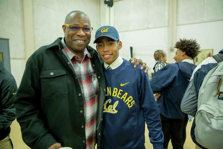 Washington National Manager and former San Francisco Giants Manager Dusty Baker (left) with his son Darren Baker at a National Letter of Intent celebration where Darren selected University of  California at Berkeley on February 1, 2017 at Jesuit High School in Carmichael, Calif.
