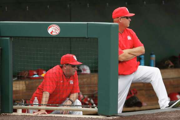 Houston head coach Todd Whitting (left) and assistant coach Trip Couch watch from the steps of the dugout during the NCAA baseball game between the Cincinnati Bearcats and the Houston Cougars at Schroeder Park on Saturday, May 20, 2017, in Houston, TX.