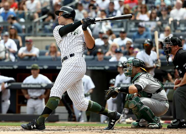 NEW YORK, NY - MAY 28:  Aaron Judge #99 of the New York Yankees hits a grand slam in the third inning as Josh Phegley #19 of the Oakland Athletics defends on May 28, 2017 at Yankee Stadium in the Bronx borough of New York City.  (Photo by Elsa/Getty Images)