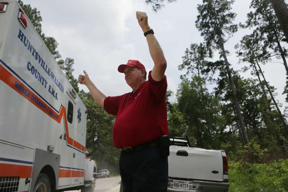 Steve Degner from Montgomery Search and Rescue thumbs up the ambulance transporting Ezra, the three-year-old boy that went missing at the Sam Houston National Forest.  Sunday, May 28, 2017, in Waverly. ( Marie D. De Jesus / Houston Chronicle ) Photo: Marie D. De Jesus/Houston Chronicle