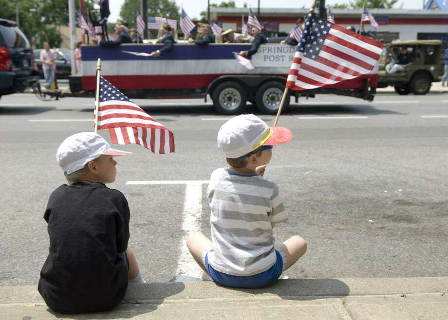Stephen Shuford, 6, and his brother Christopher, 4, of Redding, watch the annual Memorial Day parade in on Sunday, May 27, 2007. Photo: File Photo / 00003170A