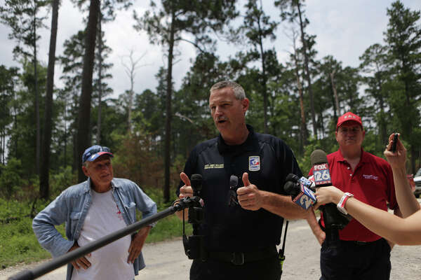 Captain Jimmy Williams, spokesman for the New Waverly Fire Department, informs the press that Ezra, 3-year-old missing in Sam Houston National Forest has been rescued and transported to the hospital in The Woodlands, Sunday, May 28, 2017, in Waverly. ( Marie D. De Jesus / Houston Chronicle )