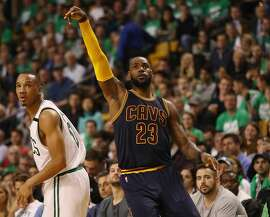 BOSTON, MA - MAY 25:  LeBron James #23 of the Cleveland Cavaliers celebrates his three point shot that made him the all time playoff points leader, passing Michael Jordan in the third quarter against the Boston Celtics during Game Five of the 2017 NBA Eastern Conference Finals at TD Garden on May 25, 2017 in Boston, Massachusetts. NOTE TO USER: User expressly acknowledges and agrees that, by downloading and or using this photograph, User is consenting to the terms and conditions of the Getty Images License Agreement.  (Photo by Elsa/Getty Images)