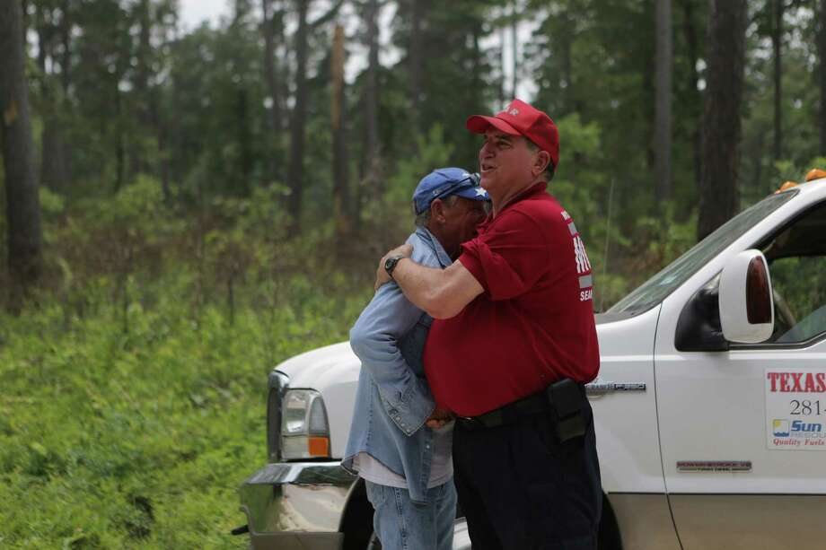 Rescuers Steve Degner, right, and Tim Miller, left, hugged relieved and happy that Ezra, the three-year-old child that went missing at the Sam Houston National Park was found, Sunday, May 28, 2017, in Waverly. ( Marie D. De Jesus / Houston Chronicle ) Photo: Marie D. De Jesus, Staff / © 2017 Houston Chronicle