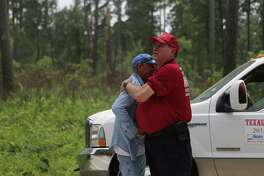 Rescuers Steve Degner, right, and Tim Miller, left, hugged relieved and happy that Ezra, the three-year-old child that went missing at the Sam Houston National Park was found, Sunday, May 28, 2017, in Waverly. ( Marie D. De Jesus / Houston Chronicle )