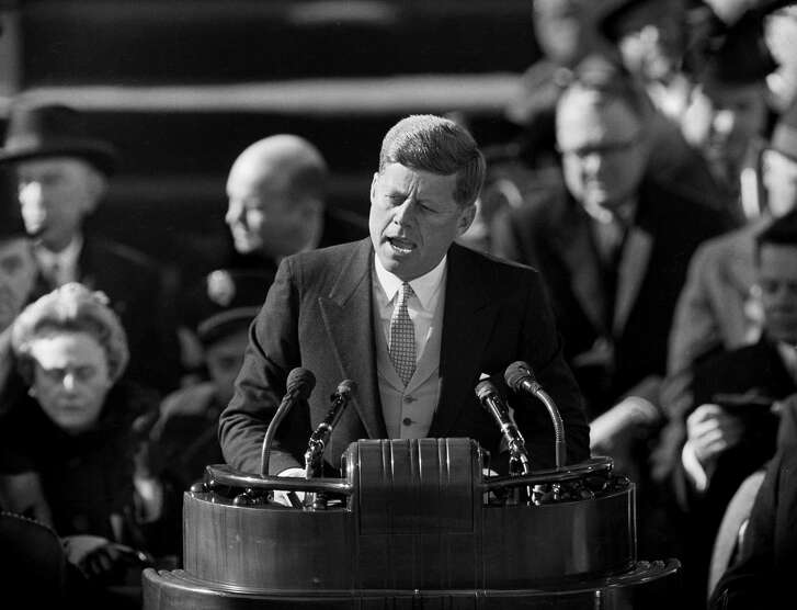 FILE - In this file photo dated Jan. 20, 1961, U.S. President John F. Kennedy delivers his inaugural address at Capitol Hill in Washington, after taking the oath of office. Celebrating his 100th birthday on Monday, his legacy on women's rights is recalled. (AP Photo, File)
