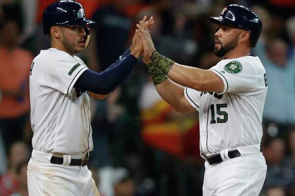 Houston Astros Carlos Correa (1), and  Carlos Beltran (15) celebrate their runs scored on Marwin Gonzalez's RBI double during the second inning of an MLB baseball game at Minute Maid Park, Sunday, May 28, 2017.