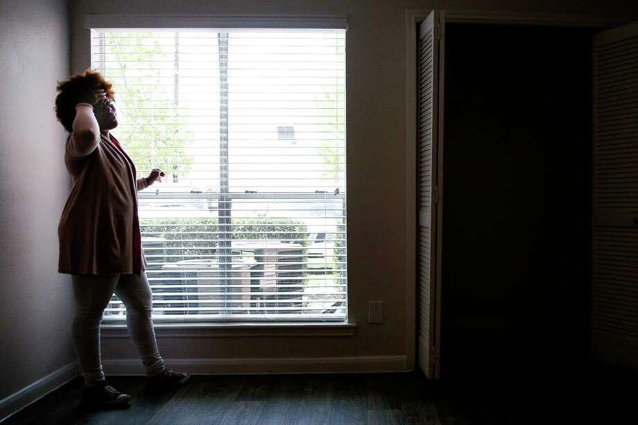 Montoya Thomas, then 20, holds her head in her hand as she looks out the window of her new apartment Monday, May 8, 2017 in Houston. Thomas, who aged out of foster care in May, received a housing voucher through the Houston Housing Authority, but it was revoked because of federal budget uncertainty. Harris County's HAY Center Foundation stepped in to provide Thomas assistance with her rent. Photo: Michael Ciaglo, Houston Chronicle / Michael Ciaglo