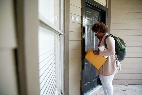 Montoya Thomas, then 20, opens the door to her new apartment Monday, May 8, 2017 in Houston.
