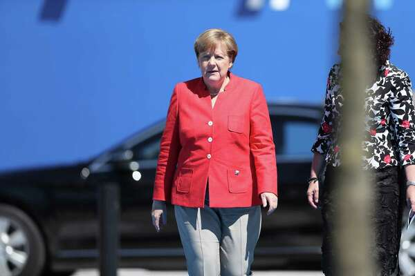 "After contentious meetings with President Trump last week, German Chancellor Angela Merkel, seen here on Thursday arriving for NATO meetings, declared a new chapter in U.S.-European relations, saying that Europe ""really must take our fate into our own hands."""