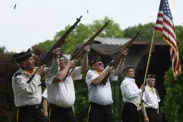 Byram veterans, from left, John Zmarzlak, Jim McMurray and Carl Jensen fire ceremonial shots during a ceremony following the annual Byram Veterans Association Memorial Day Parade in Greenwich, Conn. Sunday, May 28, 2017. Members of the Byram Veterans marched through the streets with town leaders before a small ceremony of remembrance and honor in front of the Byram Shubert Library.