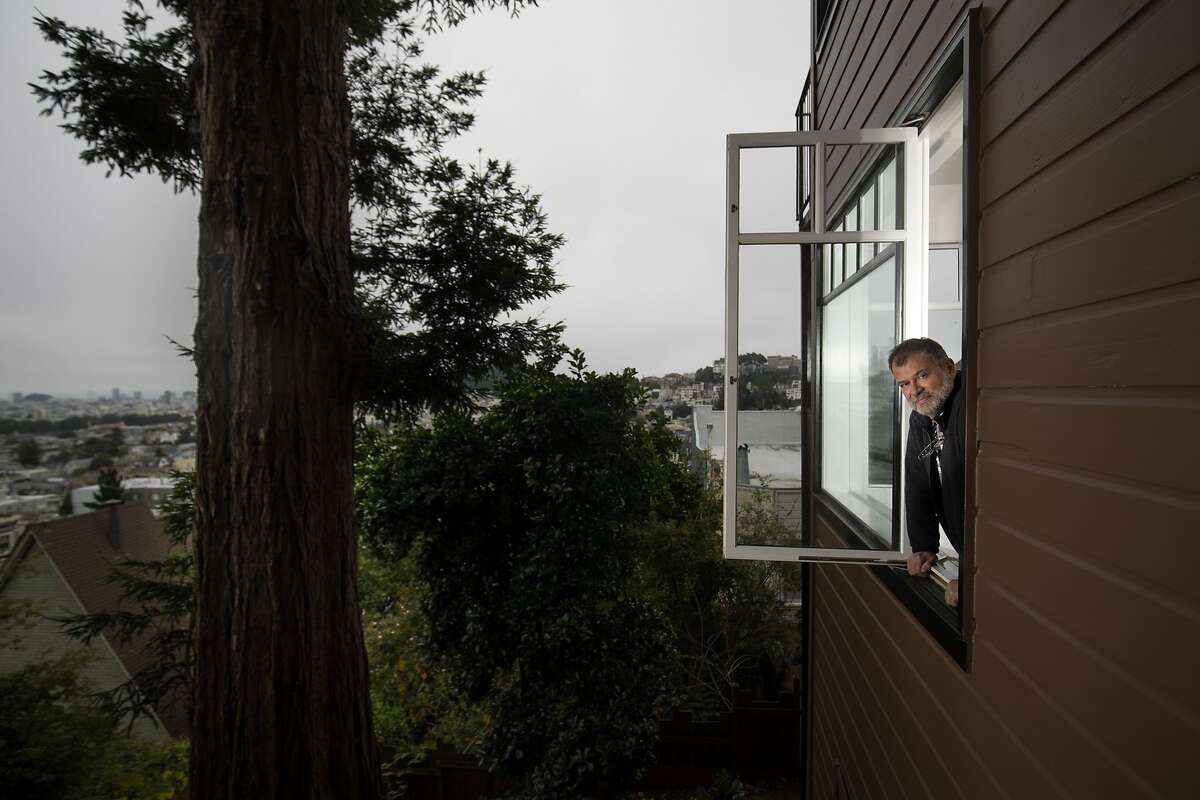 French author Martin Winckler in his temporary apartment with a view on 05-28-17, San Francisco, California. Winckler is the first writer in residence in a new program at the French Consul's house in Cole Valley. The consul, Emmanuel Lebrun-Damiens, has a separate apartment below his and decided to put it to good use by starting a residency, ?A Room with a View,? for French artists.
