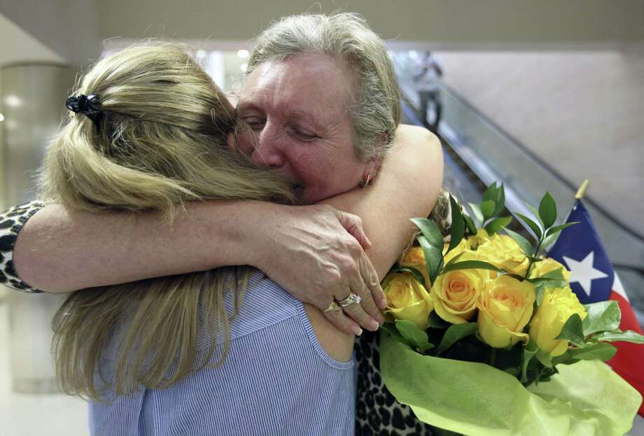 Jackie Rutter, facing camera, of London, hugs her San Antonio pen pal of almost 50 years, Casey Gray, as they meet Thursday, May 25, 2017 at the San Antonio International Airport for the first time. Photo: William Luther, Staff / San Antonio Express-News / © 2017 San Antonio Express-News