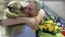 Jackie Rutter, facing camera, of London, hugs her San Antonio pen pal of almost 50 years, Casey Gray, as they meet Thursday, May 25, 2017 at the San Antonio International Airport for the first time.