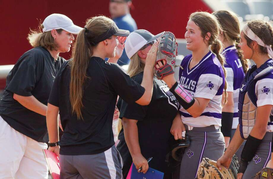 Willis starting pitcher Casey Dixon (10) gets a high-five after striking out Rebecca Miller #99 of Barbers Hill to end the third inning in Game 2 of a Region III-5A final high school softball series at Cougar Softball Stadium, Saturday, May 27, 2017, in Houston. Photo: Jason Fochtman, Staff Photographer / © 2017 Houston Chronicle