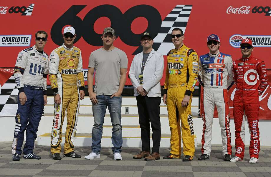 NASCAR's Brad Keselowski (left) and Joey Logano, actor Channing Tatum, director Steven Soderbergh and drivers Kyle Busch, Ryan Blaney and Kyle Larson. Photo: Chuck Burton, Associated Press