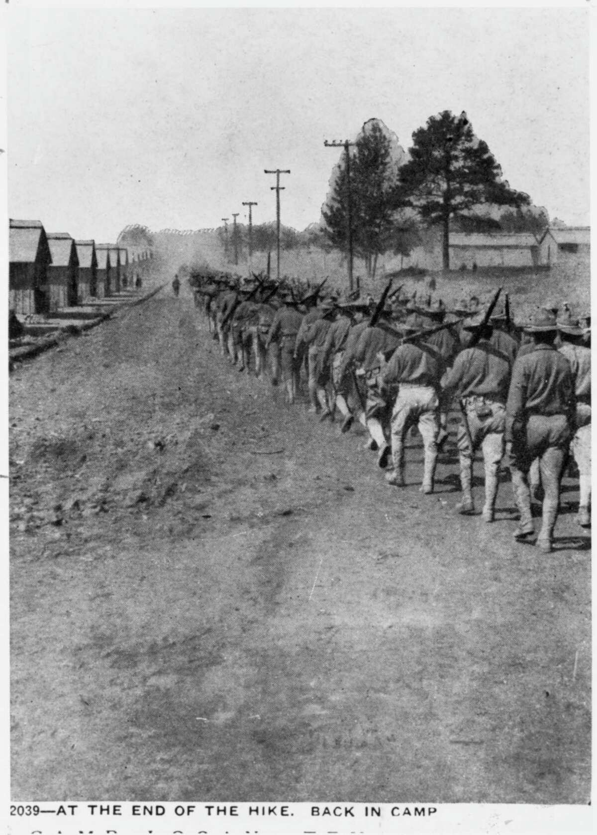 Soldiers in training for service in World War 1, heading back to Camp Logan after a hike through the area that is now known as Memorial Park. This photograph is among those belonging to the Houston Public Library that chronicle the history of Houston.