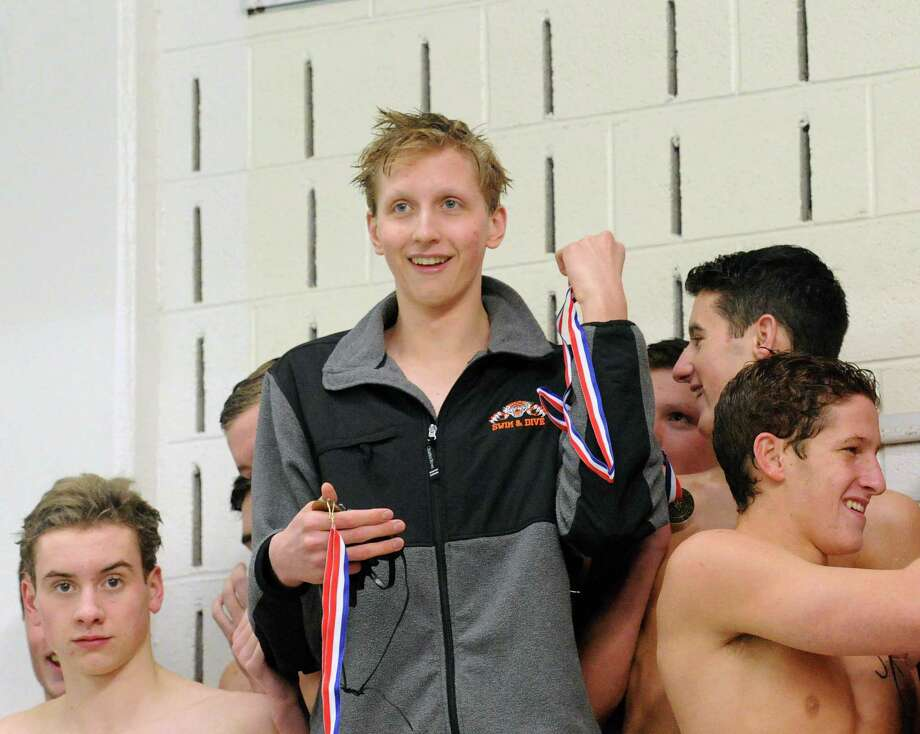 Ridgefield's Kieran Smith, center, on the winner's platform celebrating with the Ridgefield High School 200-medley relay team that took first place during the FCIAC Boys High School Swimming Championships at Greenwich High School on March 2. Photo: Bob Luckey Jr. / Hearst Connecticut Media / Greenwich Time