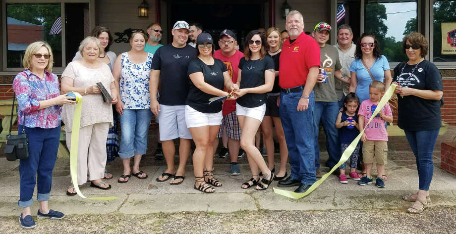 The Coldspring/San Jacinto County Chamber of Commerce welcomes the Lake Livingston Information Center on May 27 with a ribbon cutting ceremony. Owner Angelica Lynch (left) and Director Tara Ames (right) cut the ribbon to commemorate their welcoming. Photo: Submitted