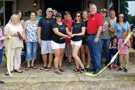 The Coldspring/San Jacinto County Chamber of Commerce welcomes the Lake Livingston Information Center on May 27 with a ribbon cutting ceremony. Owner Angelica Lynch (left) and Director Tara Ames (right) cut the ribbon to commemorate their welcoming.