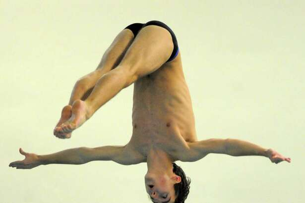 Darien's Timmy Luz competes in the FCIAC diving championship at Westhill High School pool in Stamford on March 1.
