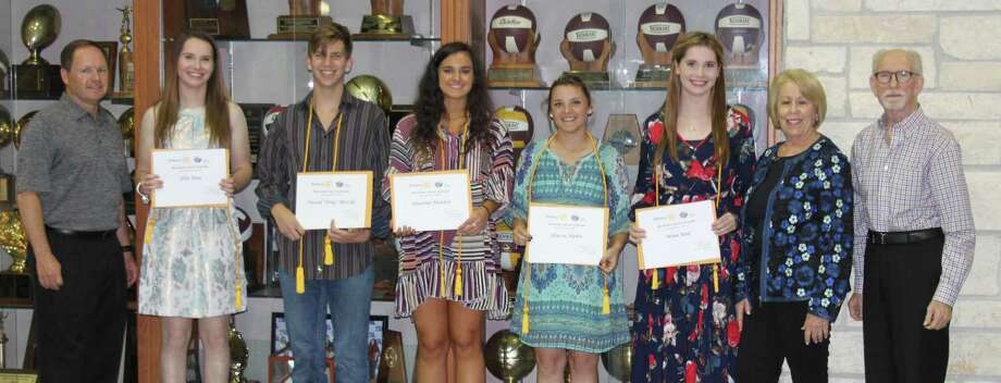 "Scott Lambert (left), Tommie Daniel (right) and Ernestine Belt (second from right) present five Tarkington seniors with the Cleveland Rotary Club scholarships. Left to right: Lambert, Ellie Rau, David ""Trai"" McCall, Shianne Hunter, Alyssa Alpha, Nina Rau, Belt and Daniel. Photo: Jacob McAdams"