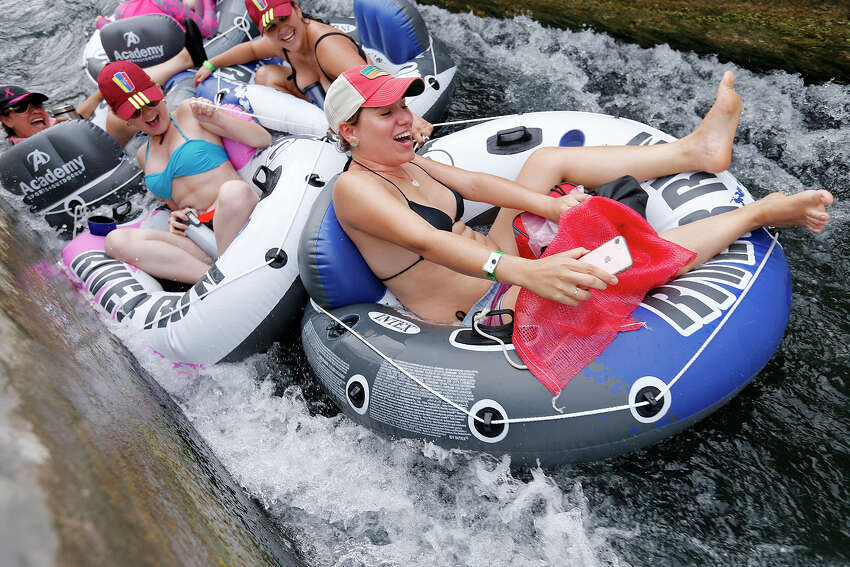 Tubers enjoy the tube chute in Prince Solms Park on the Comal River Sunday May 28, 2017 in New Braunfels, Tx.