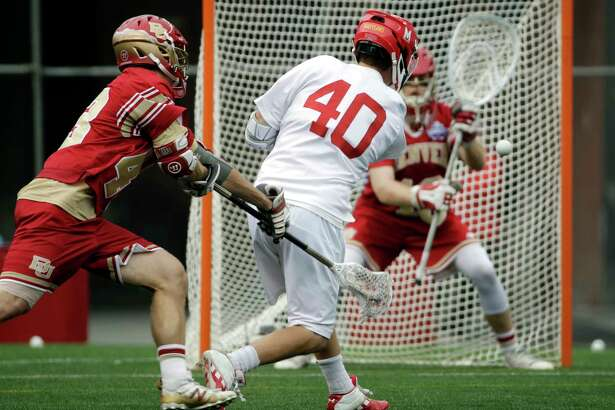 Maryland's Connor Kelly (40) moves past the defense of Denver's Christian Thomas, left, to score against goalkeeper Alex Ready (16) during the second half of an NCAA college Division 1 lacrosse semifinal, Saturday, May 27, 2017, in Foxborough, Mass. (AP Photo/Elise Amendola) ORG XMIT: MAEA115