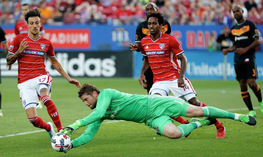 FC Dallas forward Maximiliano Urruti (37) and FC Dallas forward Atiba Harris (14) close in on the soccer ball as Houston Dynamo goalkeeper Tyler Deric (1) leaps onto it during the first half as FC Dallas hosted Houston Dynamo at Toyota Stadium in Frisco on Sunday, May 28, 2017. Photo: Stewart F. House, Special Contributor / Stewart F. House Photography