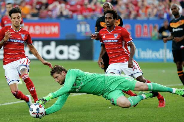 FC Dallas forward Maximiliano Urruti (37) and FC Dallas forward Atiba Harris (14) close in on the soccer ball as Houston Dynamo goalkeeper Tyler Deric (1) leaps onto it during the first half as FC Dallas hosted Houston Dynamo at Toyota Stadium in Frisco on Sunday, May 28, 2017.