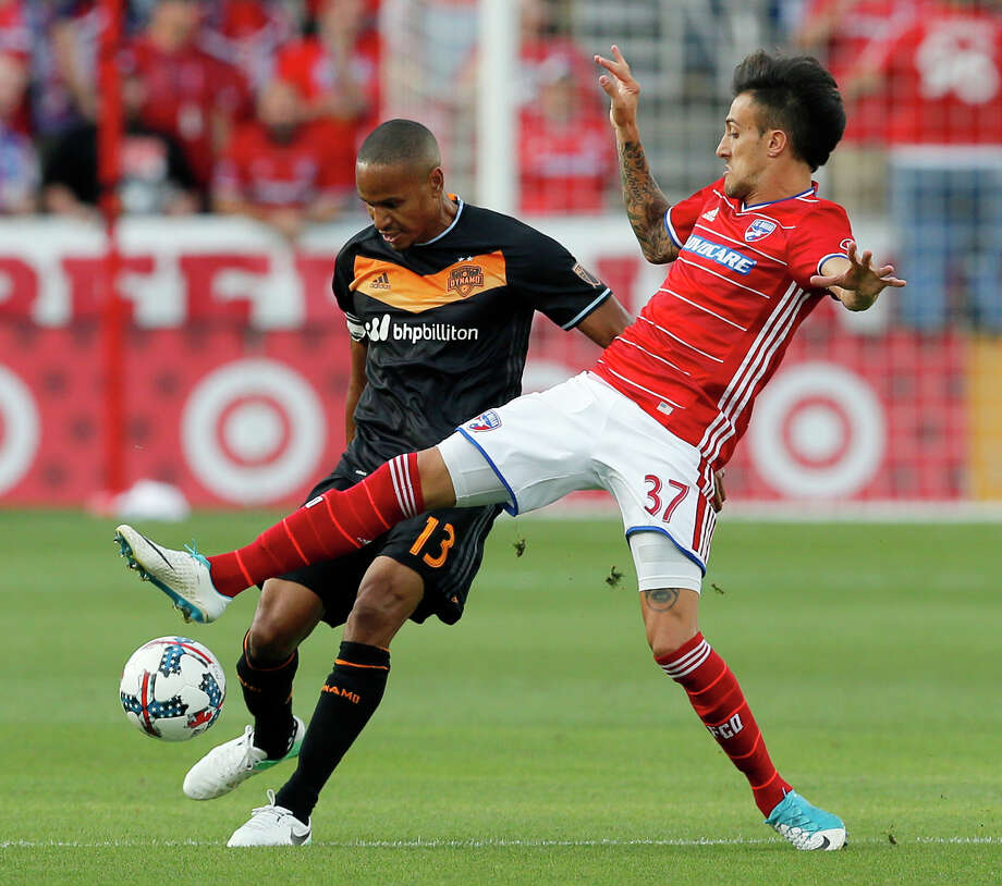FC Dallas forward Maximiliano Urruti (37) challenges Houston Dynamo's Ricardo Clark (13) for control of the ball in the first half of an MLS soccer game, Sunday, May 28, 2017, in Frisco, Texas. (AP Photo/Tony Gutierrez) Photo: Tony Gutierrez, Associated Press / Copyright 2017 The Associated Press. All rights reserved.