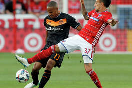 FC Dallas forward Maximiliano Urruti (37) challenges Houston Dynamo's Ricardo Clark (13) for control of the ball in the first half of an MLS soccer game, Sunday, May 28, 2017, in Frisco, Texas. (AP Photo/Tony Gutierrez)