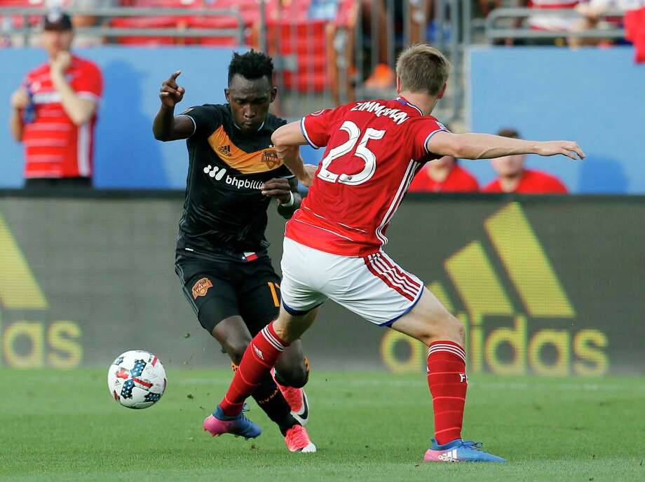 Houston Dynamo's Alberth Elis, left, loses control of the ball against FC Dallas's Walker Zimmerman, right, in the first half of an MLS soccer game, Sunday, May 28, 2017, in Frisco, Texas. Zimmerman was injured on the play and left the game with an unknown injury. (AP Photo/Tony Gutierrez) Photo: Tony Gutierrez, Associated Press / Copyright 2017 The Associated Press. All rights reserved.