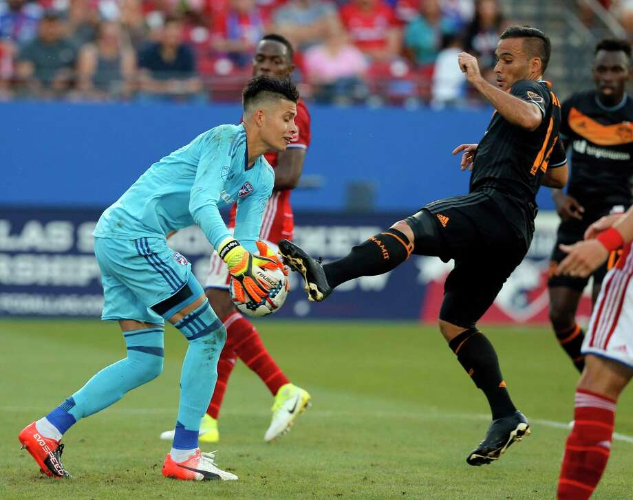 FC Dallas goalkeeper Jesse Gonzalez, left, takes control of the ball under pressure from Houston Dynamo midfielder Alex, right, in the first half of an MLS soccer game, Sunday, May 28, 2017, in Frisco, Texas. (AP Photo/Tony Gutierrez) Photo: Tony Gutierrez, Associated Press / Copyright 2017 The Associated Press. All rights reserved.