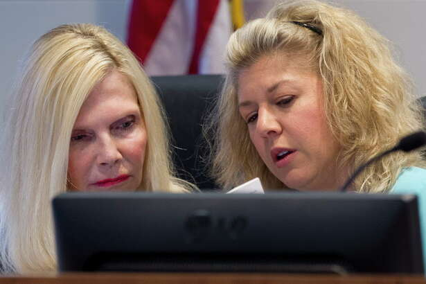 Ann Snyder, left, and Laura Fillault with The Woodlands Township Board of Directors are seen during a meeting April 26 in The Woodlands. Fillault is spearheading a Sept. 11 remembrance event.