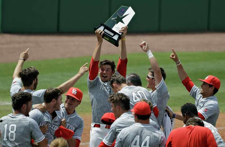 Handling the AAC tournament trophy was an uplifting experience for UH pitcher Carter Henry.