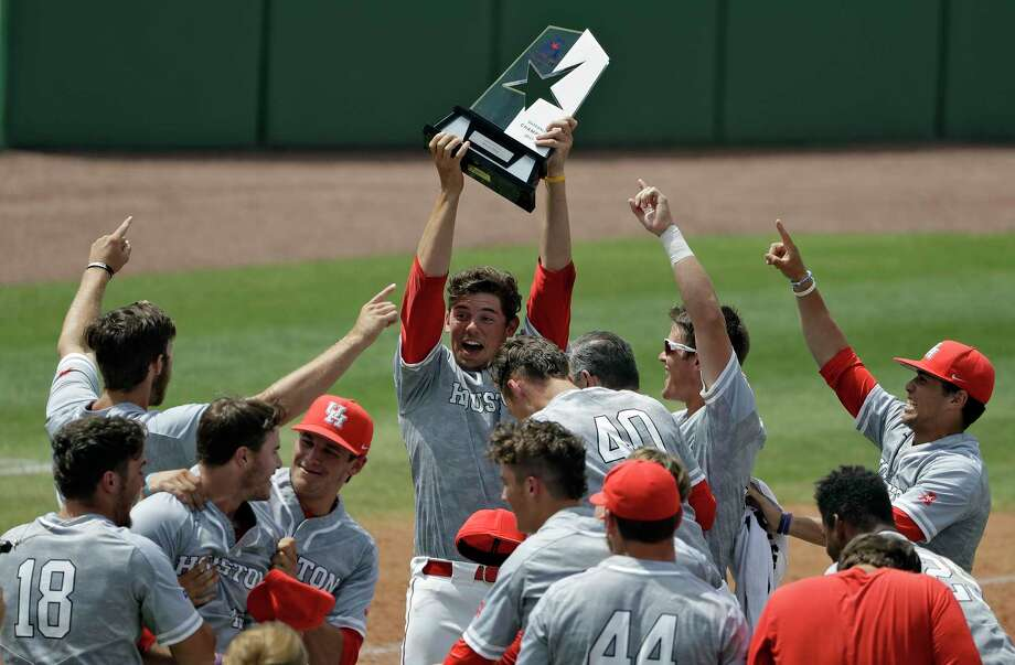 Handling the AAC tournament trophy was an uplifting experience for UH pitcher Carter Henry. Photo: Chris O'Meara, STF / Copyright 2017 The Associated Press. All rights reserved.