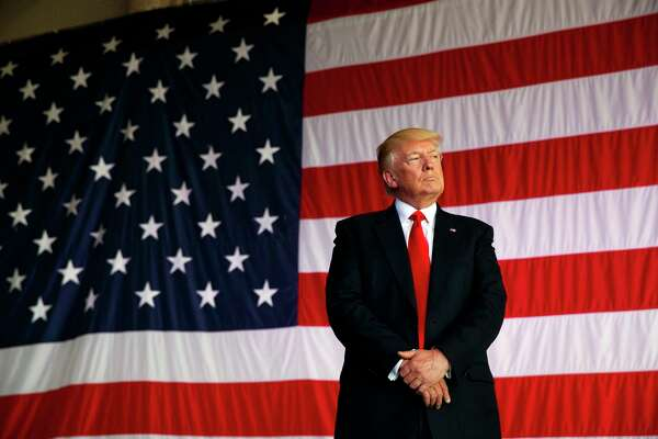 President Donald Trump is introduced to speak to U.S. military troops at Naval Air Station Sigonella, Saturday, May 27, 2017, in Sigonella, Italy. (AP Photo/Evan Vucci) ORG XMIT: ITAV128