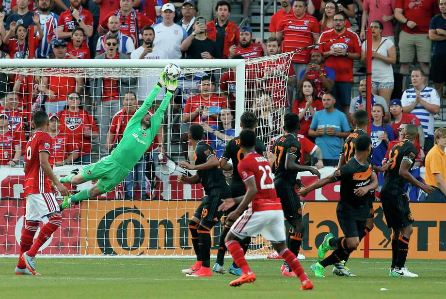 Dynamo goalkeeper Tyler Deric stretches out to make a save on a free kick by FC Dallas in the first half Sunday night in Frisco. Photo: Tony Gutierrez, STF / Copyright 2017 The Associated Press. All rights reserved.
