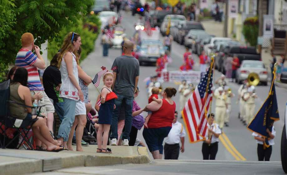 People line the sides along Broadway to watch the City of Rensselaer's Memorial Day Parade on Sunday, May 28, 2017, in Rensselaer, N.Y.  (Paul Buckowski / Times Union) Photo: PAUL BUCKOWSKI / 40040621A
