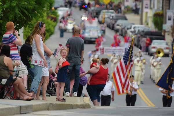 People line the sides along Broadway to watch the City of Rensselaer's Memorial Day Parade on Sunday, May 28, 2017, in Rensselaer, N.Y.  (Paul Buckowski / Times Union)