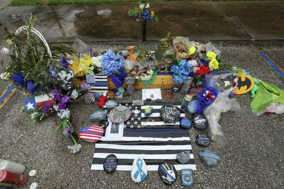 Mourners created a makeshift memorial at the Harris County courthouse annex in Baytown where deputy constable Clint Greenwood was shot and killed April 3.