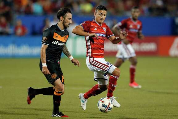 Houston Dynamo forward Vicente Sanchez (10) and FC Dallas midfielder Mauro Diaz, right, compete for control of the ball in the second half of an MLS soccer game, Sunday, May 28, 2017, in Frisco, Texas. (AP Photo/Tony Gutierrez)