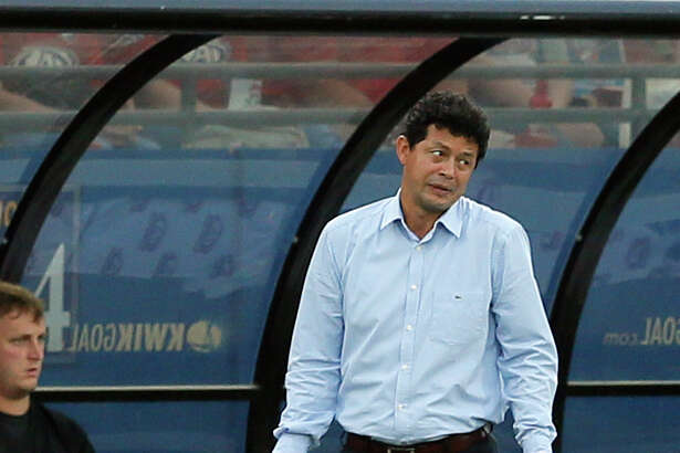 Houston Dynamo head coach Wilmer Cabrera reacts to play against FC Dallas in the first half of an MLS soccer game, Sunday, May 28, 2017, in Frisco, Texas. (AP Photo/Tony Gutierrez)