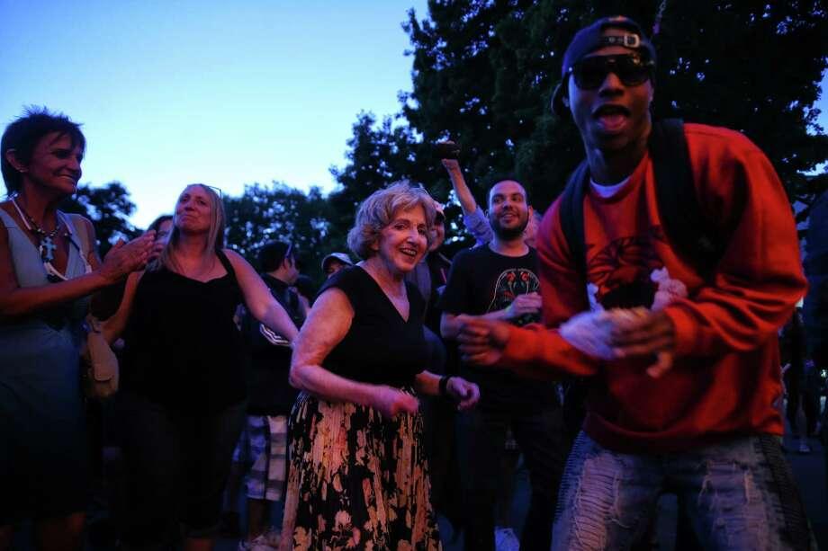 Beth Placek, center, and others dance as Banda La Mejor performs during the 2017 Northwest Folklife Festival at Seattle Center, Sunday, May 28, 2017. Photo: GENNA MARTIN, SEATTLEPI.COM / SEATTLEPI.COM