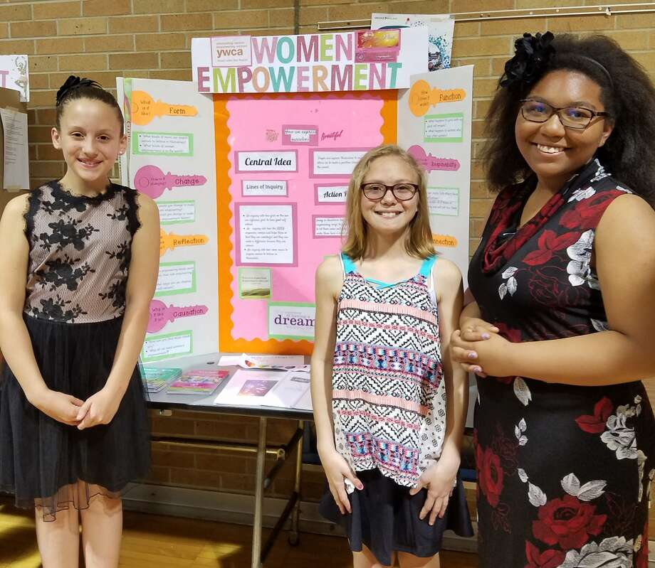 Chestnut Hill students Parker Dill, Blaise Mayer and Samylah Bryant present their project May 9.