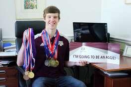Friendswood High School graduating senior Joachim Bendixen wears academic medals won during the school year. He plans to study engineering at Texas A&M University.