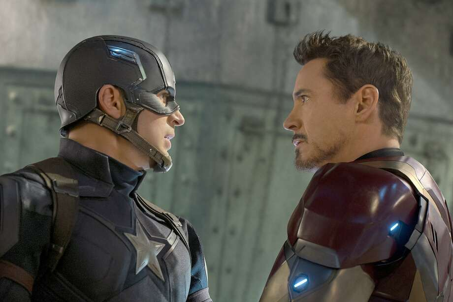 """Two of Marvel's biggest stars and leading Avengers square off in """"Captain America: Civil War"""": The film's title character, played by Chris Evans, left, and Tony Stark, portrayed by Robert Downey Jr. in another smooth turn. MUST CREDIT: Zade Rosenthal, Marvel Photo: Zade Rosenthal, Marvel"""